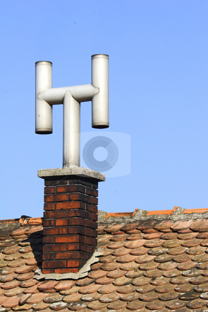Old tin chimney pot stock photo, Old tin chimney pot on roof by Mark Yuill