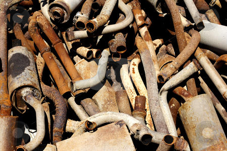 Old rusting  exhaust systems stock photo, Old rusting exhaust systems piled up in a scrap yard by Mark Yuill