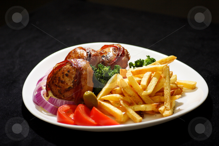 Stuffed turkey with bacon and cheese stock photo, Turkey medallion stuffed with kymac cheese and bacon served with french fries  and green vegtables by Mark Yuill