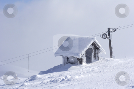 Snow shelter on mountain top  stock photo, Ice covered snow shelter on mountain top by Mark Yuill
