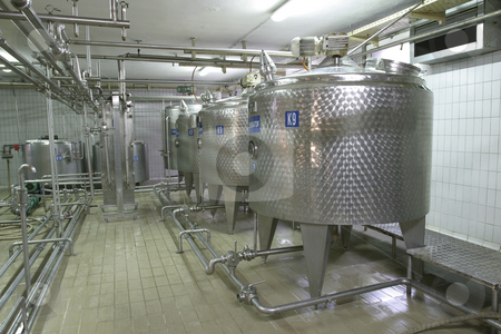 Temperature controlled pressure tanks in factory stock photo, Stainless steel temperature controlled pressure tanks in factory by Mark Yuill
