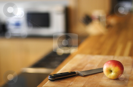 Apple and knife stock photo, Aplle knife and cutting board by Mark Yuill