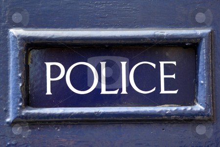 Old police sign  stock photo, Old police sign in frame painted blue by Mark Yuill