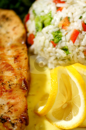 Lemon chicken with rice stock photo, Grilled chicken breast with rice and lemon sauce by Mark Yuill