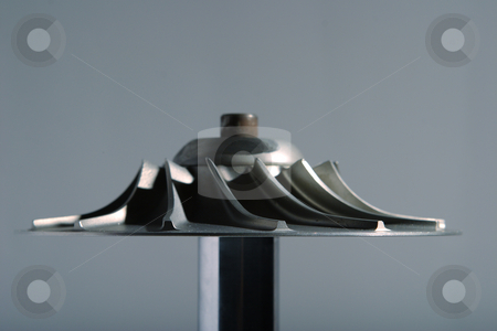 Precision engineered turbine stock photo, Precision engineered turbine with a gray background by Mark Yuill
