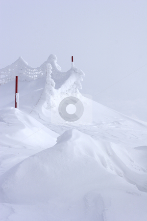 Snow drift at top of mountain stock photo, Wind swept snow drift at top of mountain by Mark Yuill