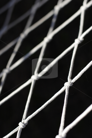 Close up photograph  of net stock photo, close up photograph of a net on black background by Mark Yuill