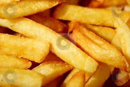 French fries stock photo, Close up photograph of french frie or chips, by Mark Yuill