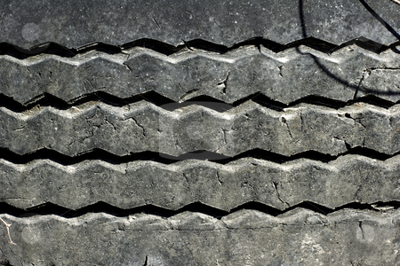 Pattern on rubber vehicle tyre stock photo, Close up of pattern on rubber vehicle tyre by Mark Yuill