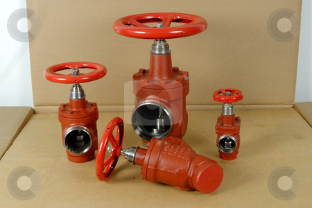 Industrial valves stock photo, New industrial valves on carboard packing by Mark Yuill