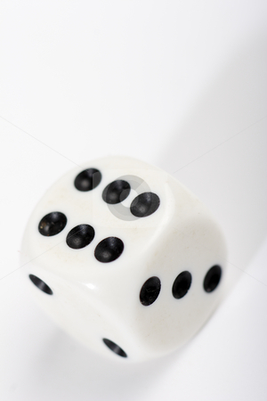 Dice stock photo, White dice on pale background by Mark Yuill