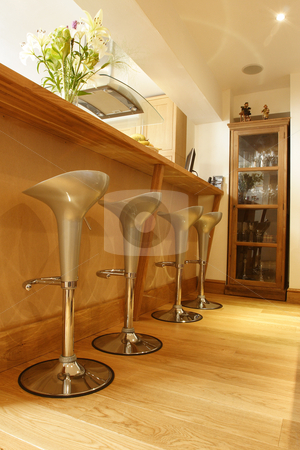 Crome stools on wooded floor stock photo, Crome stools on wooded floor by Mark Yuill