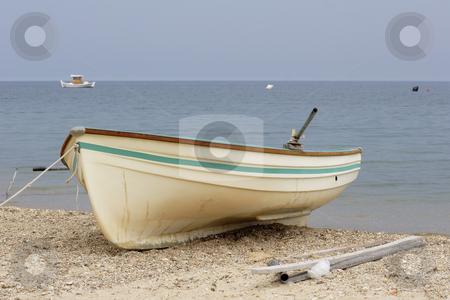 Greek fishing boats stock photo, Greek fishing boats anchored off the beach by Mark Yuill