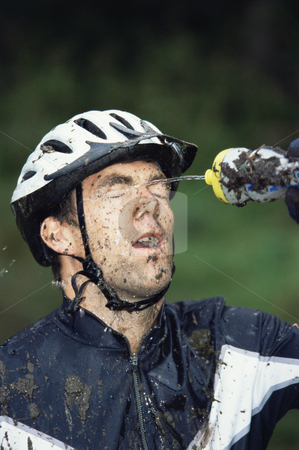 Mountain biker refreshing  stock photo,  by Monkey Business Images