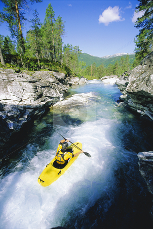 Young man kayaking in river stock photo,  by Monkey Business Images