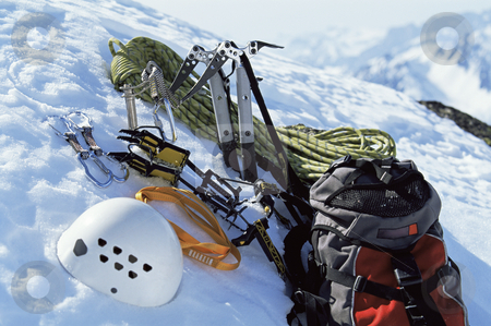 Mountain climbing equipment in snow stock photo,  by Monkey Business Images