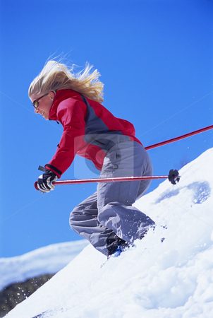 Young woman skiing stock photo,  by Monkey Business Images