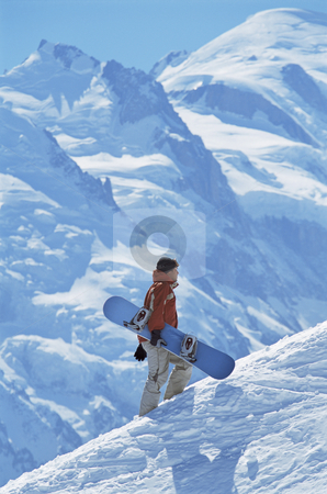 Young man snowboarding stock photo,  by Monkey Business Images