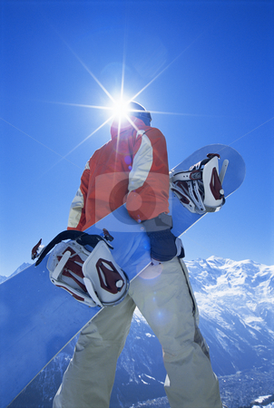 Young man with snowboard stock photo,  by Monkey Business Images