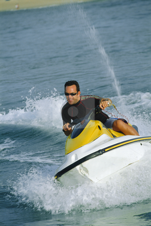 A man on a jet ski stock photo,  by Monkey Business Images