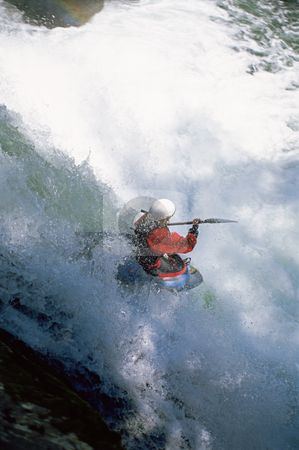 Young woman kayaking in rapids stock photo,  by Monkey Business Images