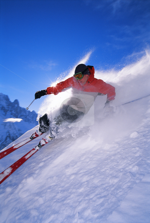 Young man skiing stock photo, Young man skiing down slope by Monkey Business Images