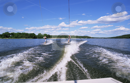 A man and woman water-skiing stock photo,  by Monkey Business Images