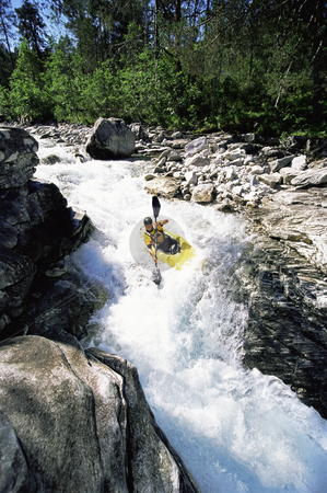 Young man kayaking in rapids stock photo,  by Monkey Business Images