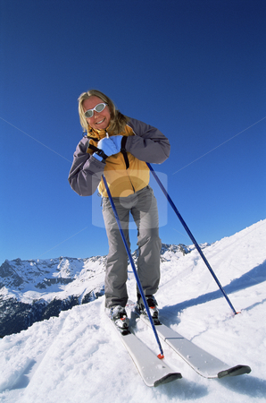 Young woman skiing stock photo, Young woman skiing by Monkey Business Images