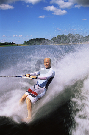 Man water skiing stock photo, Man water skiing by Monkey Business Images