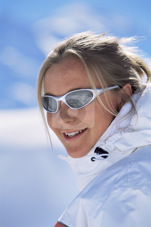 Young woman smiling stock photo, Young woman smiling on ski slopes by Monkey Business Images