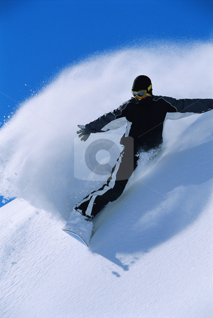 Young woman snowboarding stock photo, Young woman snowboarding by Monkey Business Images