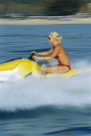 A woman on a jet ski stock photo, A woman on a jet ski by Monkey Business Images