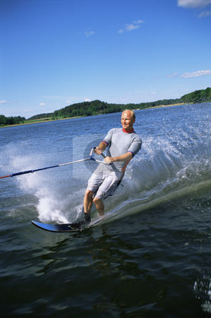 Man water skiing stock photo, A young man water skiing by Monkey Business Images