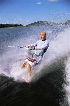 Barefoot water skiing stock photo, A man water skiing barefoot by Monkey Business Images
