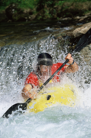 Young man kayaking stock photo, Young man kayaking in river by Monkey Business Images
