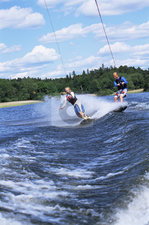 Water-skiing stock photo, A man and woman water-skiing by Monkey Business Images