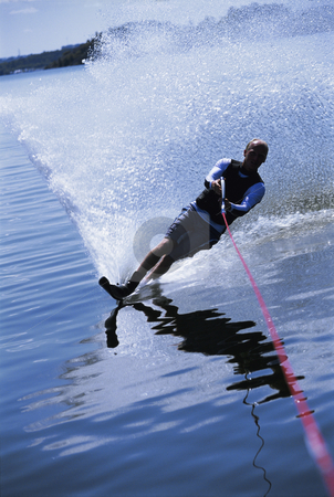 Water skiing stock photo, A young man water skiing by Monkey Business Images