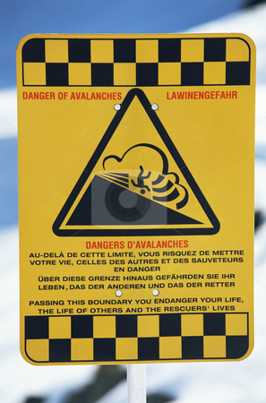 Warning sign in a snow covered area stock photo,  by Monkey Business Images