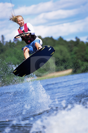A young woman water skiing stock photo, A young woman water skiing by Monkey Business Images