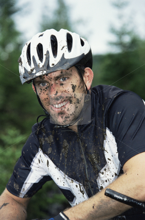 Mountain biker stock photo, Mountain biker covered in mud by Monkey Business Images