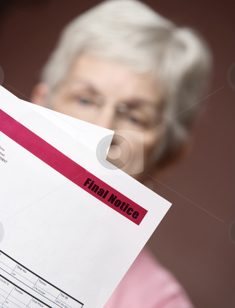 Senior woman withfinal notice stock photo, Upset senior woman with many bills and notices by Scott Griessel