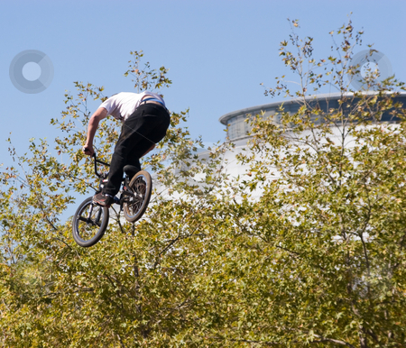 BMX Biker stock photo, A BMX biker in a aerial stunt by Nicholas Rjabow