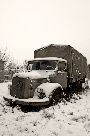 Abandoned old truck in winter stock photo, Old abandoned old truck in winter by Mark Yuill