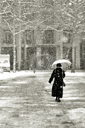 Walking in the snow stock photo, Walking in the snow by Mark Yuill