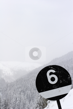 Black ski run sign number six stock photo, Black ski run sign number six by Mark Yuill