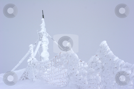 Frozen snow  stock photo, Frozen snow on fence by Mark Yuill