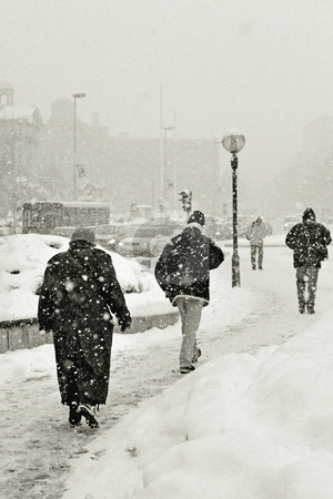 Walking in snow stock photo, Walking in snow by Mark Yuill