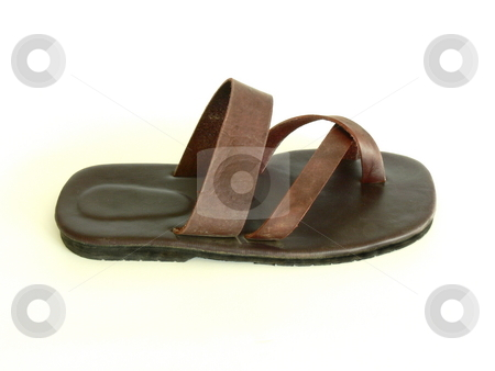 Brown Sandal stock photo, A single, flat, brown leather sandal. Side on view. Isolated on white. by Martin Darley