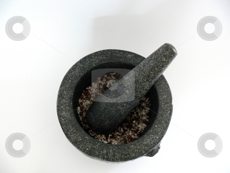 Mortar and pestle stock photo, Top view of a granite mortar and pestle containing spices. Set against a white background. by Martin Darley